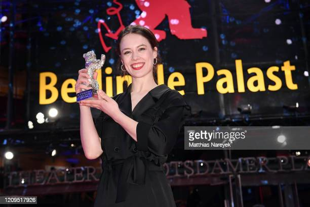 Paula Beer winner of the Silver Bear for Best Actress for the film Undine poses after the closing ceremony of the 70th Berlinale International Film...