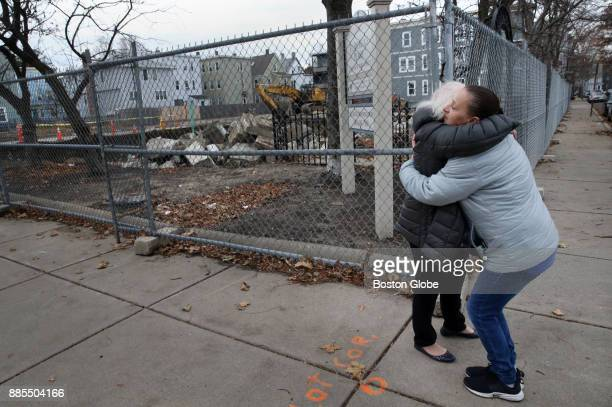 Paula Caruso right embraces her former neighbor Luz Flores on York Street where they once lived at St Patricks Place in Cambridge MA on Dec 1 2017...
