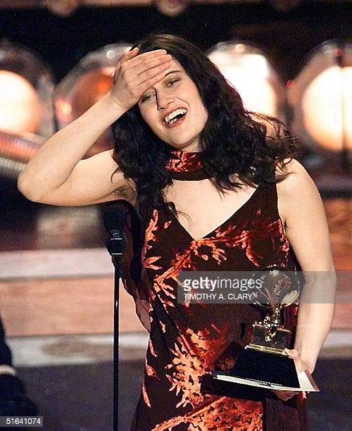 Paula Cole holds her head after winning the Best New Artist Grammy during the 40th Grammy Awards at Radio City Music Hall in New York 25 February...