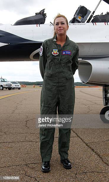 Paula Creamer 2010 Women's US Open Champion stands in front of an F16 after flying with the US Air Force Thunderbirds on September 9 2010 at the Air...