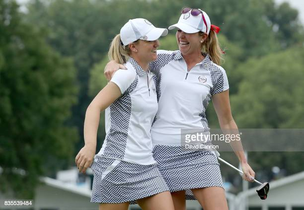 Paula Creamer and Austin Ernst of the United States Team celebrate after they had won their match by 53 against Melissa Reid and Emily Pedersen of...