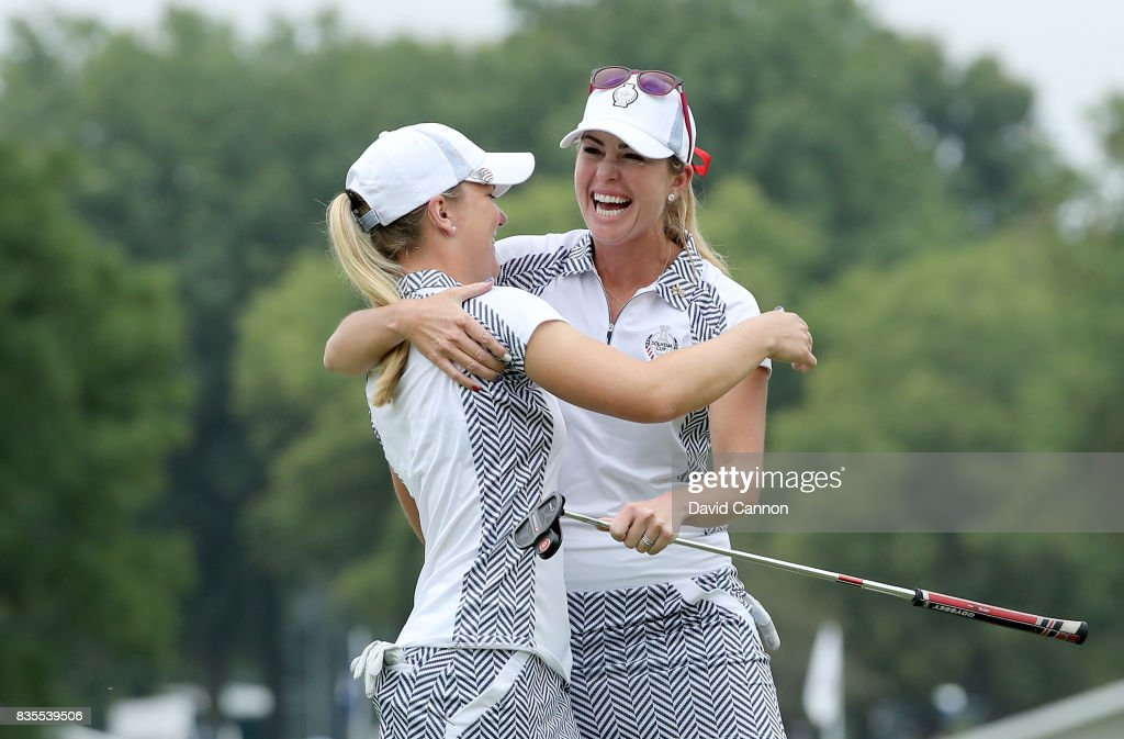 Paula Creamer and Austin Ernst of the United States Team celebrate after they had won their match by 5&3 against Melissa Reid and Emily Pedersen of the European Team during the morning fousomes matches in the 2017 Solheim Cup at Des Moines Golf Country Club on August 19, 2017 in West Des Moines, Iowa.