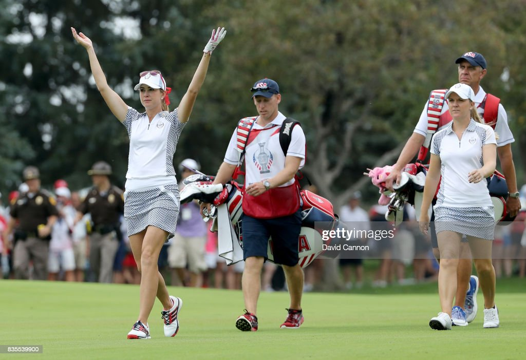 Paula Creamer and Austin Ernst of the United States Team walk down the 15th hole in their match against Melissa Reid and Emily Pedersen of the European Team during the morning fousomes matches in the 2017 Solheim Cup at Des Moines Golf Country Club on August 19, 2017 in West Des Moines, Iowa.