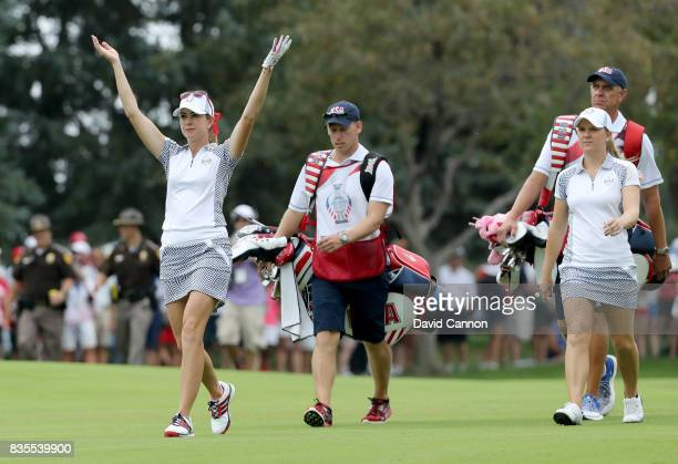 Paula Creamer and Austin Ernst of the United States Team walk down the 15th hole in their match against Melissa Reid and Emily Pedersen of the...