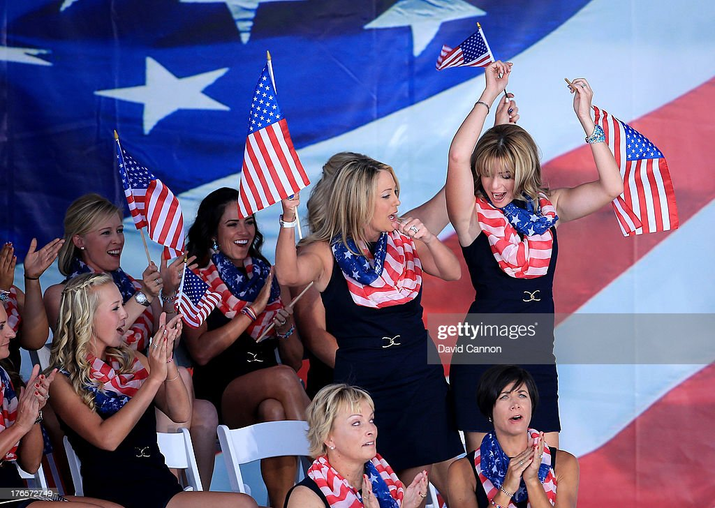 Paula Creamer (R) and Cristie Kerr of the United States Team stand and react to their pairing being announced for the morning foursomes matches at the Opening Ceremony for the 2013 Solheim Cup at The Colorado Golf Club on August 15, 2013 in Parker, Colorado.