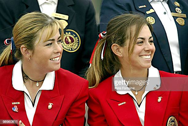 Paula Creamer and Erica Blasberg enjoy the closing ceremony of the Curtis Cup at the Formby Golf Club June 13 2004