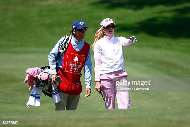 Paula Creamer and her caddie discuss a shot on the 9th hole during the third round of the SemGroup Championship presented by John Q Hammons on May 3...