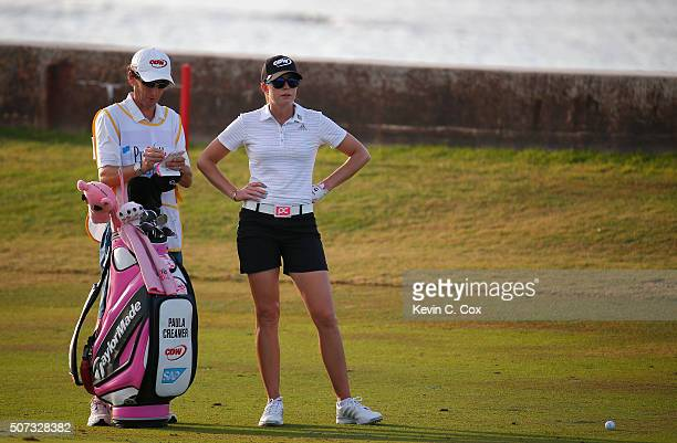 Paula Creamer and her caddie discuss her second shot on the eighth hole during the first round of the Pure Silk Bahamas LPGA Classic at the Ocean...