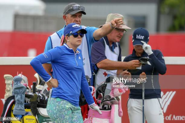 Paula Creamer and her caddie discuss the tee shot on during the First Round of the Volunteers of America Texas Classic on May 4 2018 at the Old...