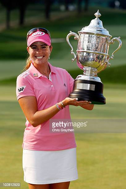 Paula Creamer celebrates with the trophy after winning the 2010 US Women's Open at Oakmont Country Club on July 11 2010 in Oakmont Pennsylvania