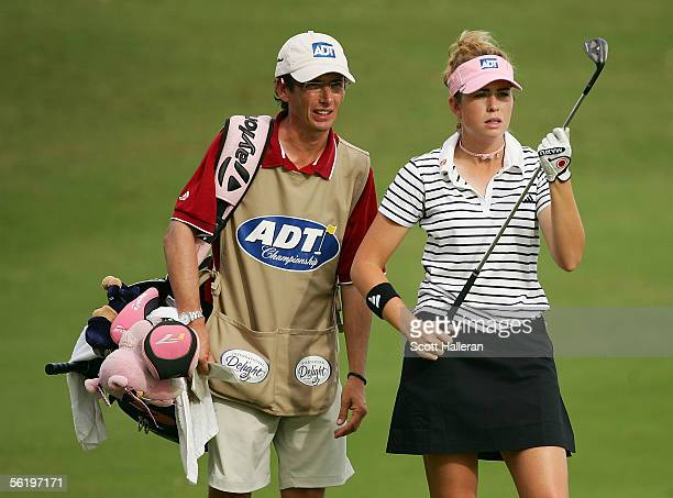 Paula Creamer chats with her caddie Colin Cann during the first round of the ADT Championship at Trump International Golf Club on November 17 2005 in...