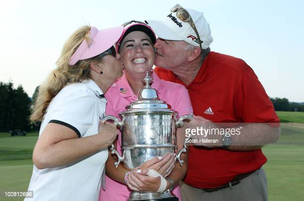 Paula Creamer is kissed by her mom Karen and her father Paul as the celebrate with the trophy after her fourstroke victory at the 2010 US Women's...