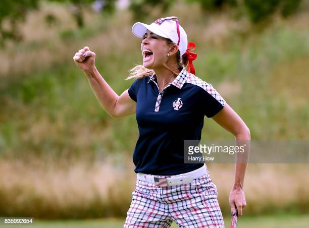 Paula Creamer of Team USA celebrates birdie on the 10th green during the final day singles matches of the Solheim Cup at the Des Moines Golf and...
