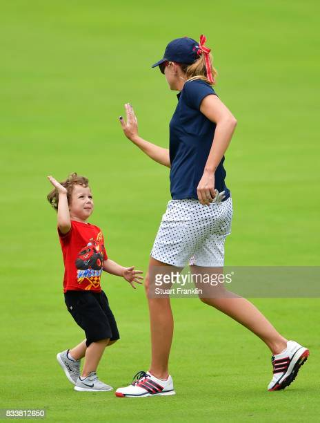 Paula Creamer of Team USA high fives with a small child during practice prior to The Solheim Cup at Des Moines Golf and Country Club on August 17...