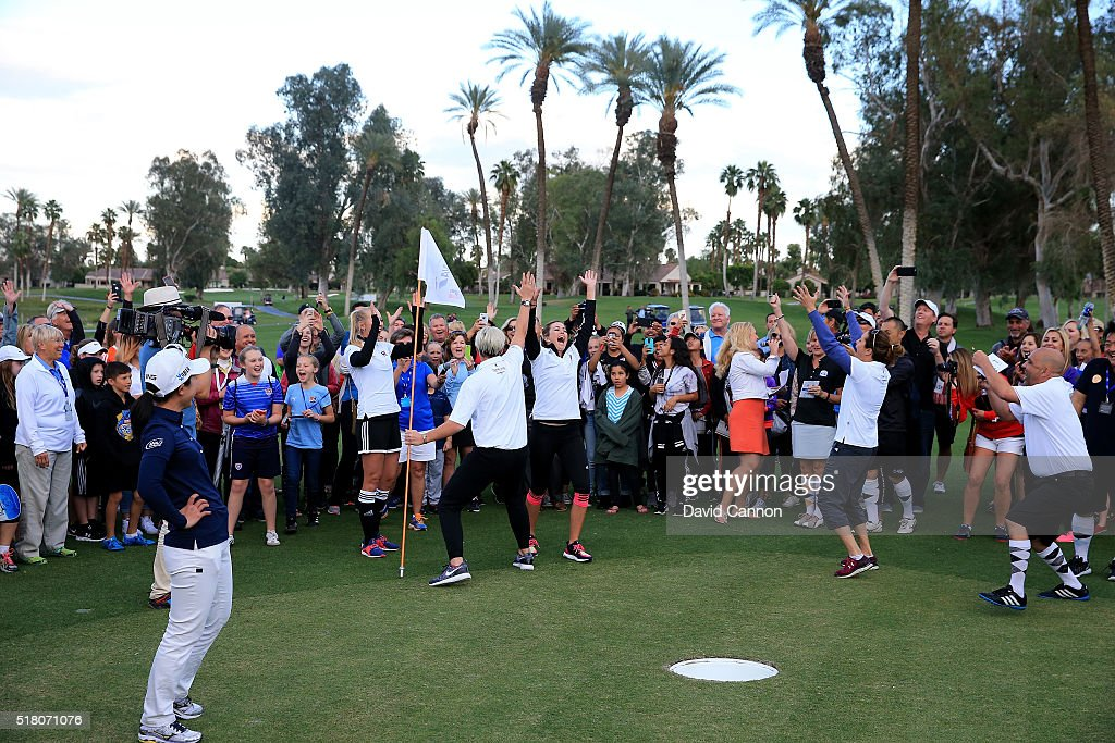 Paula Creamer of the United States celebrates with Abby Wambach of the United States as her 'foot putt' goes into the hole and the other players react during the ANA Footgolf Faceoff between Team USA and Team Japan as a preview for the ANA Inspiration at the Mission Hills Country Club on March 29, 2016 in Rancho Mirage, California.