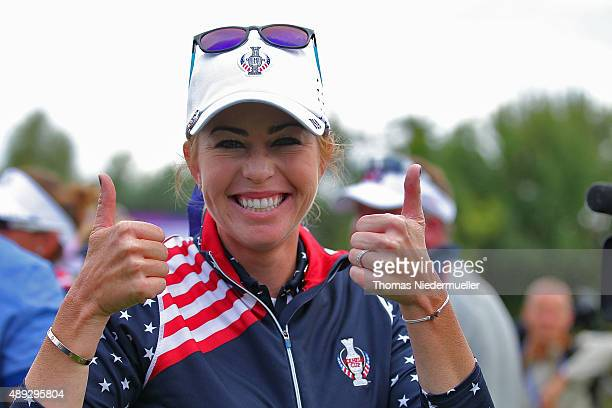 Paula Creamer of the United States Team celebrates after secoring the match winning point with her 4 and 3 win over Sandra Gal during the Sundays...
