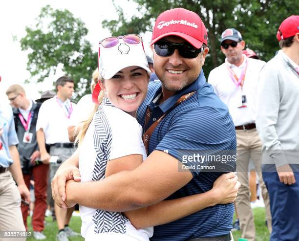 Paula Creamer of the United States Team celebrates with her husbnd Derek Heath after winning her match with Austin Ernst against Melissa Reid and...