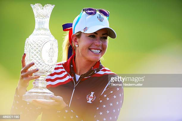 Paula Creamer of the Unitedt States Team shows the trophy after the closing ceremony at the 2015 Solheim Cup at St LeonRot Golf Club on September 20...