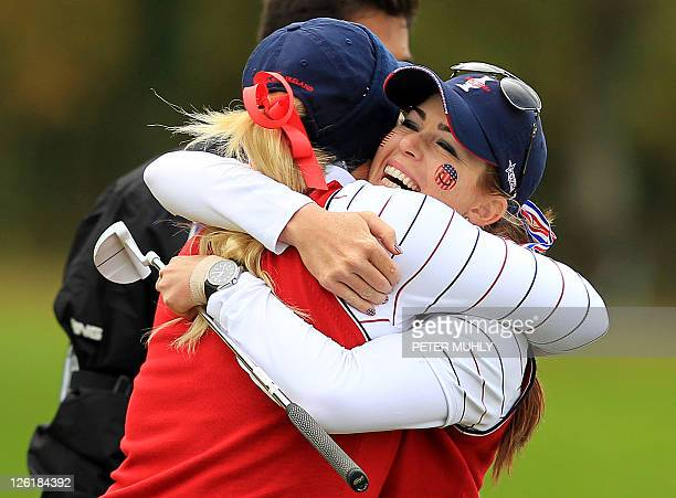 Paula Creamer of the US is hugged by teammate Brittany Lincicome during the foursomes match with Karen Stupples and Mel Reid of Europe on the first...