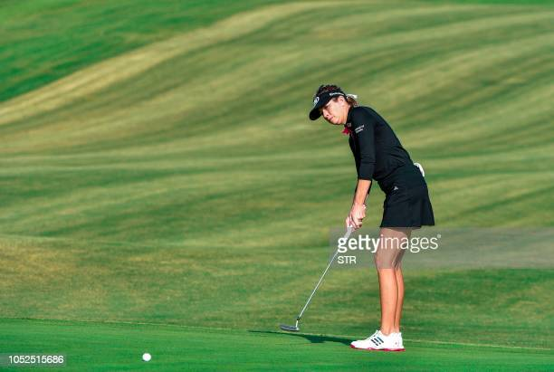 Paula Creamer of the US makes a putt during round three of the Shanghai LPGA golf tournament in Shanghai on October 19 2018 / China OUT