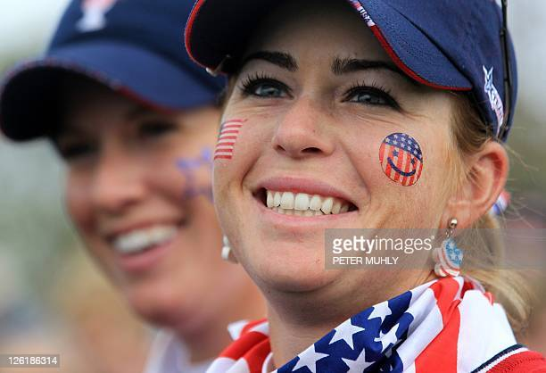 Paula Creamer of the US smiles with teammate Brittany Lincicome after winning their match during the foursomes match with Karen Stupples and Mel Reid...