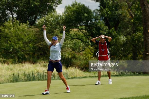 Paula Creamer of the US Team reacts after sinking a putt for birdie on the 16th hole during the Friday morning Fourball matches at the 2009 Solheim...