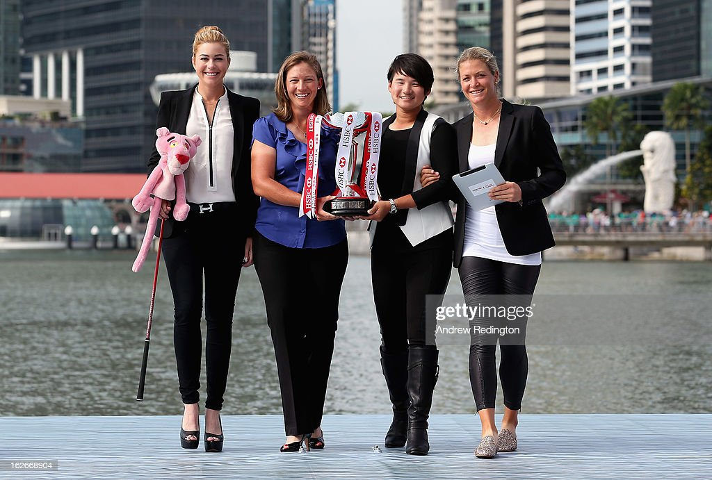 Paula Creamer of the USA, Angela Stanford of the USA, Yani Tseng of Taiwan and Suzann Pettersen of Norway walk with the trophy during a photocall in Marina Bay prior to the start of the HSBC Women's Champions at the Sentosa Golf Club on February 26, 2013 in Singapore, Singapore.