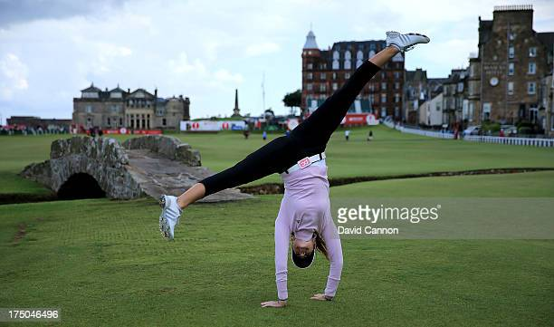 Paula Creamer of the USA cartwheels in front of the Swilken Bridge on the 18th hole during the proam as a preview for the 2013 Ricoh Women's British...