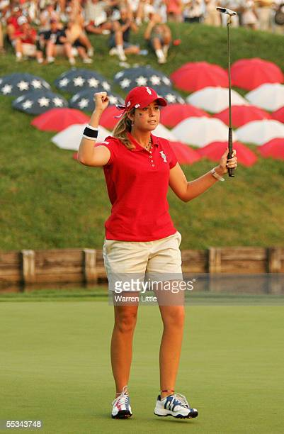 Paula Creamer of the USA celebrates on the 18th green during the Saturday Fourball matches of the 2005 Solheim Cup at Crooked Stick Golf Club on...