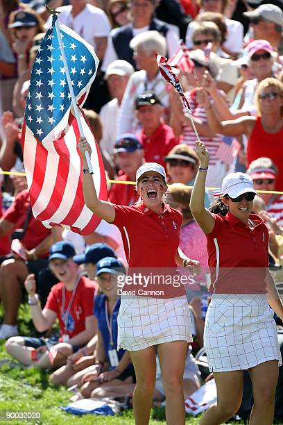 Paula Creamer of the USA celebrates the USA win during the Sunday singles matches at the 2009 Solheim Cup Matches at the Rich Harvest Farms Golf Club...