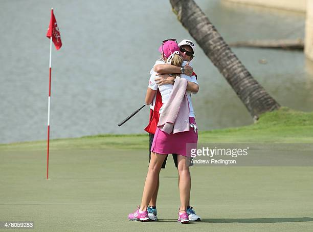 Paula Creamer of the USA celebrates with her caddie Colin Cann after holing an eagle putt to seal victory in a playoff at the HSBC Women's Champions...