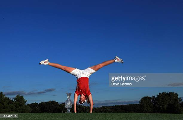 Paula Creamer of the USA does a handstand with the trophy after the Sunday singles matches at the 2009 Solheim Cup Matches at the Rich Harvest Farms...