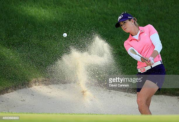 Paula Creamer of the USA plays her second shot at the par 3 16th hole during the third round of the 2014 Evian Championship at The Evian Resort Golf...