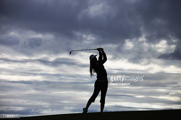 Paula Creamer of the USA plays her second shot on her first hole against the grey morning sky during the pro-am for the 2011 Ricoh Women's British...