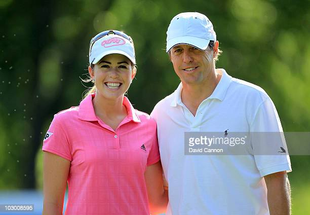 Paula Creamer of the USA poses with film star Hugh Grant of England during the proam as a preview for the 2010 Evian Masters on July 21 2010 in Evian...