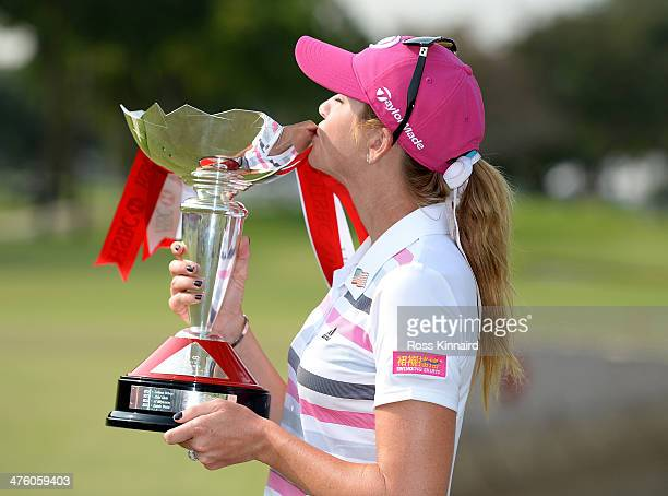 Paula Creamer of the USA poses with the trophy after sealing victory in a playoff during the final round of the HSBC Women's Champions at the Sentosa...