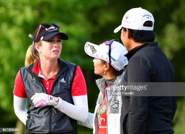 Paula Creamer of USA is consoled by Ai Miyazato of Japan during the weather delayed first round of The Evina Championship at Evian Resort Golf Club...