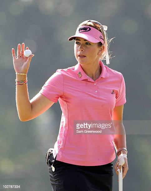Paula Creamer reacts to a birdie on the 9th hole during the continuation of round two of the 2010 US Women's Open at Oakmont Country Club on July 10...