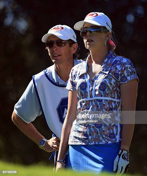 Paula Creamer talks with her caddie Colin Cann on the fourth hole during the first round of the ADT Championship at the Trump International Golf Club...