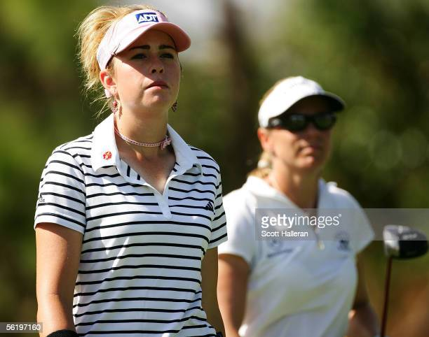Paula Creamer walks off the third tee with Annika Sorenstam of Sweden during the first round of the ADT Championship at Trump International Golf Club...