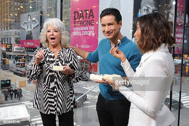 Paula Deen is interviewed by Mario Lopez and wife Courtney Mazza during her visit to 'Extra' at their New York studios at HM in Times Square on...