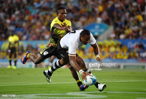 Paula Dranisinukula of Fiji goes over for a try during the Rugby Sevens Men's Pool D match between Fiji and Uganda on day 10 of the Gold Coast 2018...