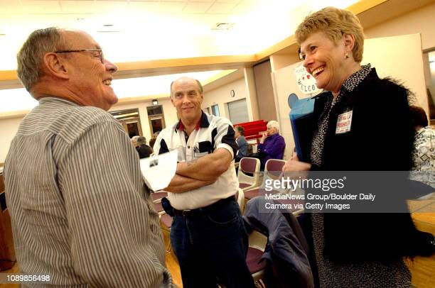 Paula Fisher right a candidate running for city council Ward 1 chats with residents Harold Olson left and Pat Johnson center Monday evening at the...