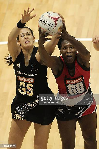 Paula Griffin of New Zealand contests a rebound with Crystal Ann George of Trinidad and Tobago during the match between New Zealand and Trinidad and...