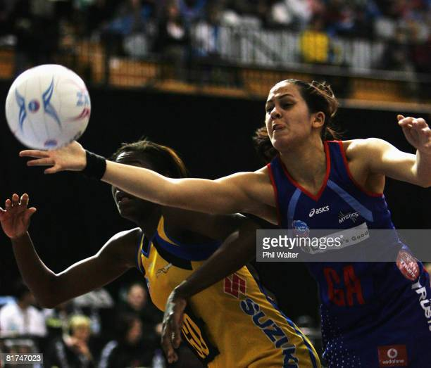 Paula Griffin of the Mystics gets to the ball ahead of Sonia Mkoloma of the Pulse during the round 12 ANZ Championships match between the Northern...