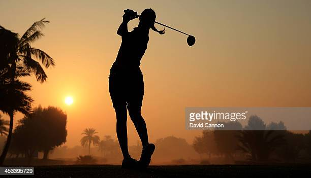 Paula Hurtado of Colombia makes a practice swing whilst waiting for the early morning fog to clear on the 10th tee before she teed off during the...