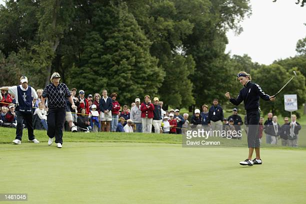 Paula Marti of Europe holes birdie putt on 9th green to win the hole as her partner Laura Davies moves in to congratulate in their match aginst...