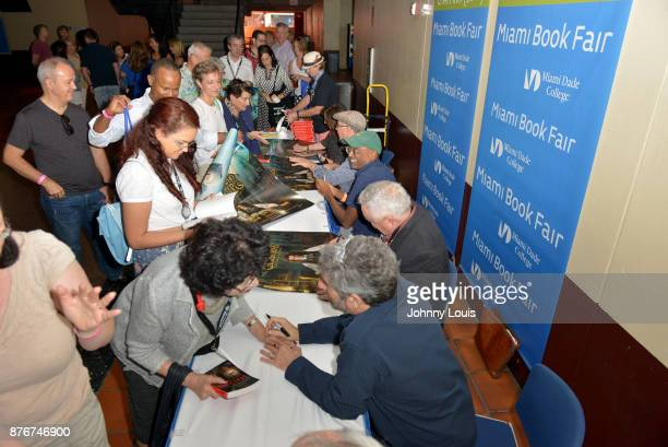 Paula Mazur Robert Mickelson Bharat Nalluri Les Standiford Mitchell Kaplan and Ian Sharples attend The Miami Book Fair at Miami Dade College Wolfson...