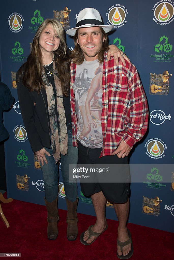 Paula Nelson and Lukas Nelson attend Hard Rock International's Wille Nelson Artist Spotlight Benefit Concert at Hard Rock Cafe, Times Square on June 6, 2013 in New York City.