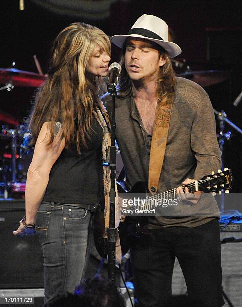 Paula Nelson and Lukas Nelson perform on stage at the Hard Rock International's Wille Nelson Artist Spotlight Benefit Concer at Hard Rock Cafe Times...